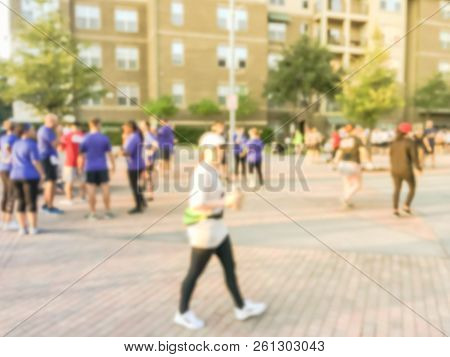 Abstract blurred multiethnic group of runners at sport event at sunrise. Defocused participants of  all abilities at 5K Corporate Challenge race in Richardson, Texas, USA, athletes warm up ready run stock photo