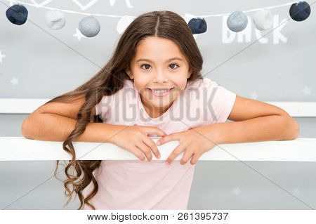 Hair every girl dream. Evening routine with long unruly hair. Child with gorgeous hairstyle smiling. Childrens tips and techniques for healthy hair. Girl cute baby with long curly hair wear pajamas. stock photo