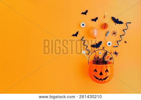 Halloween pumpkin with Halloween party objects, overhead view stock photo
