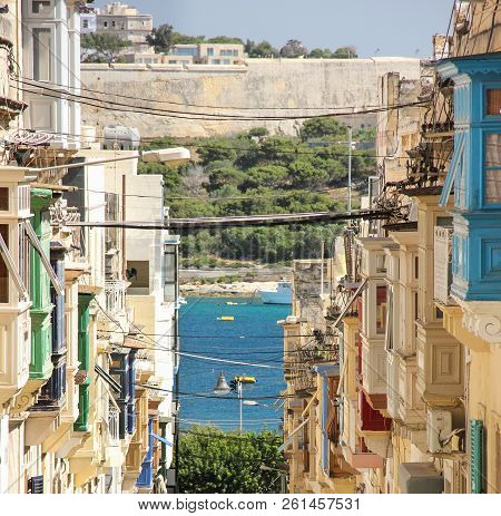 Straight street view with colorful balconies from Sliema to Manoel Island, Malta stock photo