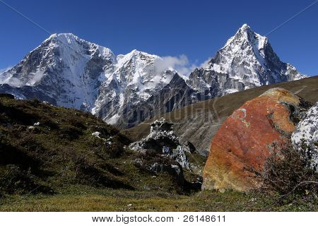 Stone looks like from another planet. In the background of six thousand mountains Cholatse and Arakam Tse. Himalayas, Nepal. stock photo
