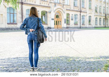 Mislead worker interview person people not ready fail false concept. Back rear view photo portrait of insane lady keeping making holding crossed fingers behind back before exam looking at doors stock photo