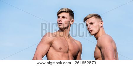 Bodybuilder shape. Men muscular athlete bodybuilder show muscles. Men muscular chest naked torso stand sky background. Strong muscles emphasize masculinity sexuality. Sexy torso attractive macho stock photo