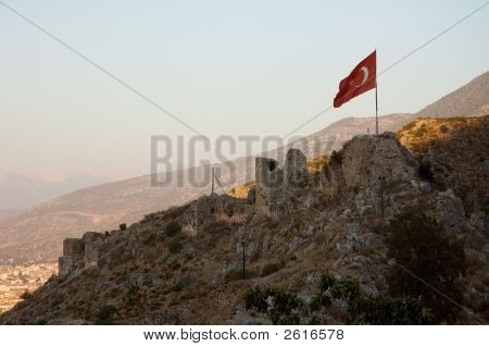 Turkish flag flattering on the ancient castle ruins near Fethye stock photo