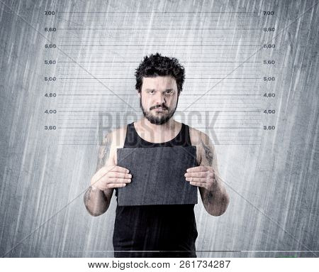 Gangster with rainy, lowering background and table on his hand. stock photo