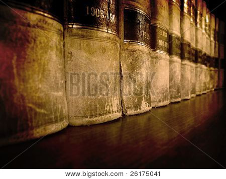 Row of old leather law books on a shelf stock photo