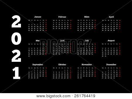 2021 year simple calendar on german language on dark background stock photo