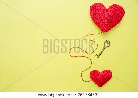 Key with two hearts as a symbol of love on the yelow background. Key of my heart concept. love valentine concept, flat lay photo.The key to the heart for true love. stock photo