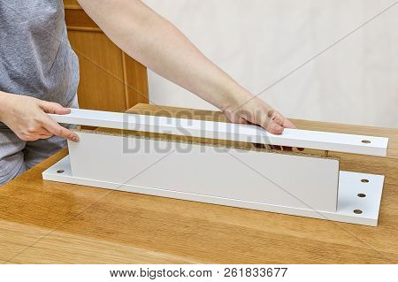 Building drawer for table using dowel joinery for butt joints on chipboard. stock photo
