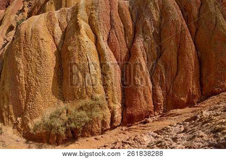 Orange,yellow and red rocks of Fairy tale gorge,Kyrgyzstan,Issyk-Kul region stock photo