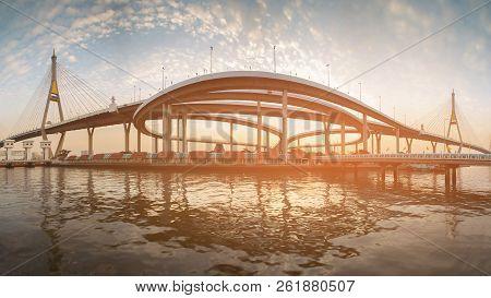 Panorama Bhumibol suspension bridge river front with sunset sky background stock photo