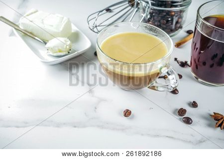 Trendy ketogenic diet food, Bulletproof coffee with milk and butter, white marble background copy space stock photo