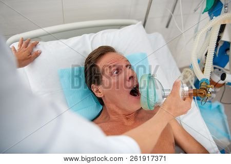 Patient waking up from coma and screaming in shock stock photo