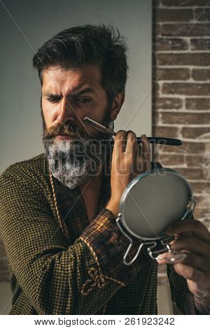 Making haircut look perfect in barber shop. Fine Cuts. Professional hairstylist in barbershop interior. Hair Preparation is just for the dashing chap. Barber - Shaves and Trims stock photo