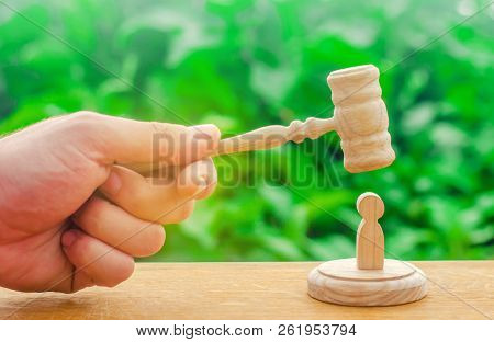 The judge's gavel hovered over the human figure. Concept of justice and litigation. The decision of the fate of the defendant. Machine repression and suppression of protests. Justice, supreme court stock photo