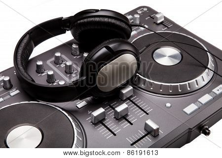 odern grey Dj mixer isolated on white background with headphones stock photo
