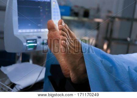 Feet of patient in operating room stock photo