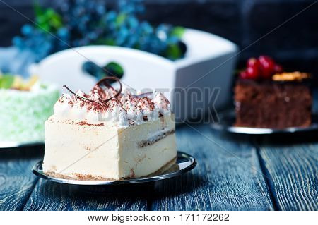 Cakes on a table a variety of cakes stock photo