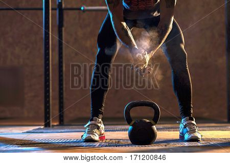 Muscular man exercising with kettlebell in gym. Weightlifting training. sports, fitness concept.