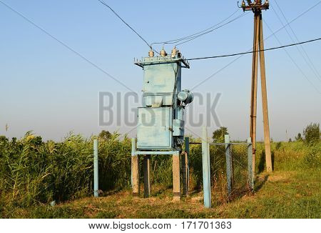 Transformers for voltage conversion. Power infrastructure. The old equipment. stock photo