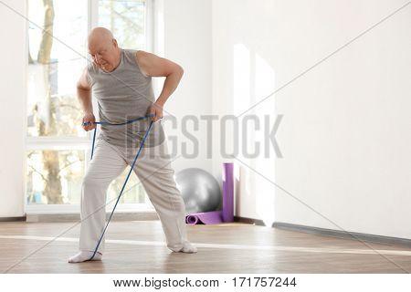 Elderly patient training in rehabilitation center stock photo