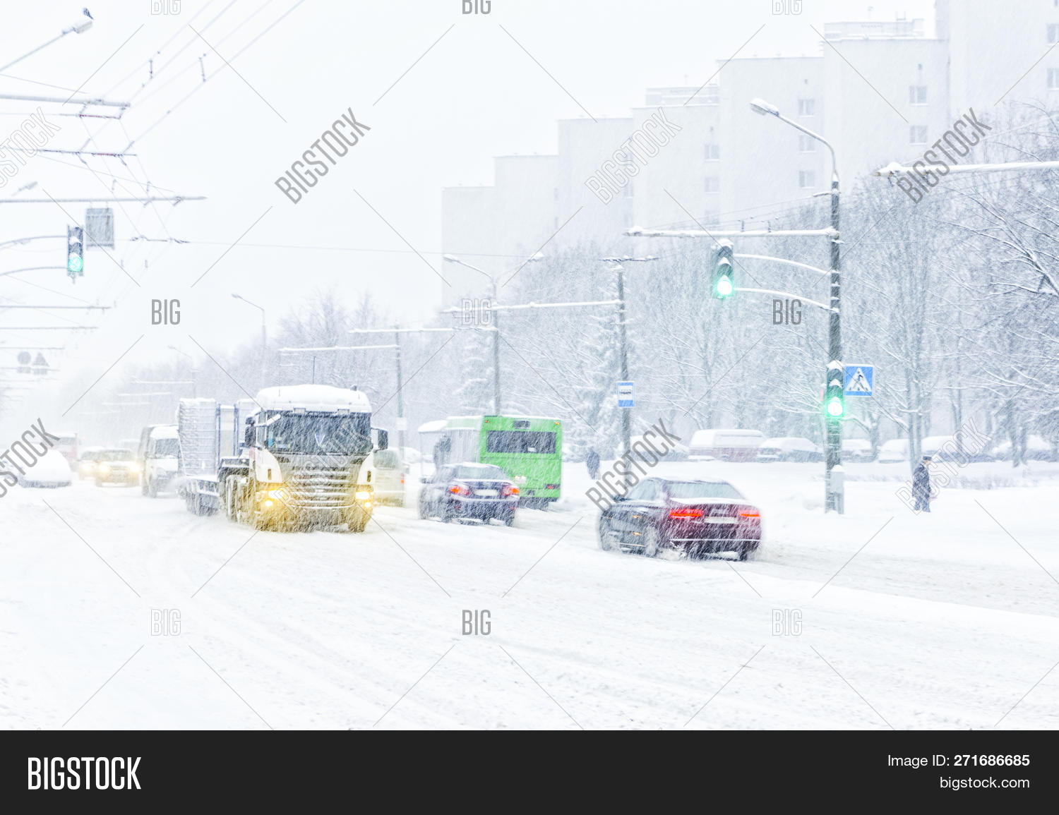 abstract,action,auto,background,between,blizzard,blurred,car,city,climate,conditions,covered,cross,crosswalk,dangerous,day,difficult,drift,drive,driver,flakes,frozen,hazard,jam,meteorology,move,pedestrian,people,relations,risk,road,safety,seasonal,silhouettes,snowfall,snowstorm,snowy,storm,street,traffic,transport,vehicle,visibility,weather,white,winter,yield