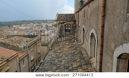 City of Noto. Province of Syracuse, Sicily. This is a view of the roofs of the city from a balcony of the San Carlo church bell tower. To the right, part of the roof of San Carlo church itself, where there´s a beatiful hidden cross stock photo