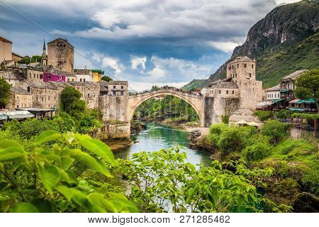 Panoramic aerial view of the historic town of Mostar with famous Old Bridge (Stari Most), a UNESCO World Heritage Site since 2005, on a rainy day with dark clouds in summer, Bosnia and Herzegovina stock photo