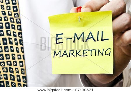 E-mail marketing post it in business man hand stock photo