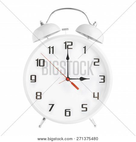 White alarm clock showing three oclock isolated on white background. stock photo