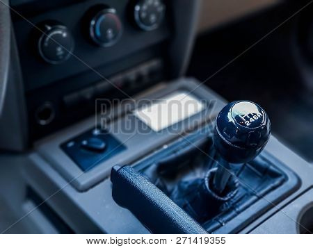 Gear shift knob close up shot on a truck, shallow depth of field, space for text. stock photo