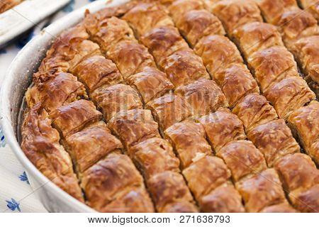 Baklava: traditional turkish pastry sweet food on alluminium tray stock photo