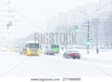 Pedestrian crossing during a snow storm. Silhouettes of people crossing the roadway covered with a thick layer of snow. Winter city concept stock photo