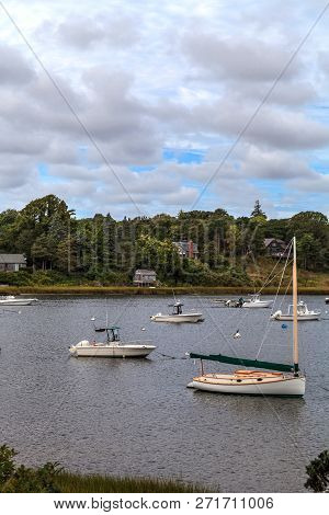 New Orleans, Cape Cod, Massachusetts, USA - September 12, 2015: Sailboats and fishing boats anchor in a harbor in New Orleans on Cape Cod at the end of Summer. stock photo