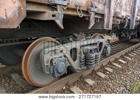 A bogie of old rusty freight railcar, side view, closeup stock photo