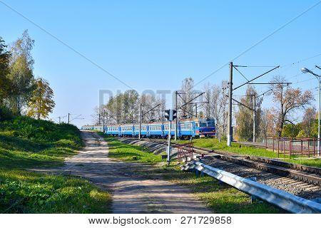 Electric train travels to the train station for boarding passengers in Russia. stock photo