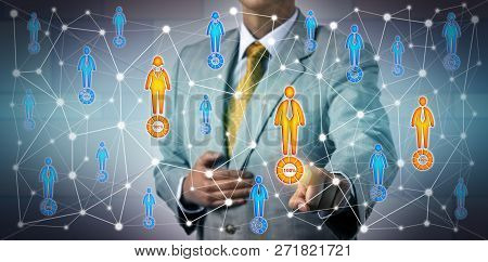 Businessman choosing male and female prospects with 100% potential in a professional network. Business and information technology concept for marketing, prospecting, performance review, HR, CRM, P2P. stock photo