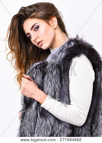 Boutique selling fur. Girl makeup face long hairstyle wear fur vest white background. Luxury fur accessory. Fashion trend concept. Winter fashionable wardrobe. Silver fur vest fashion clothing stock photo