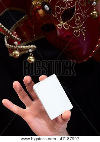 The jokerin in mask with white card stock photo