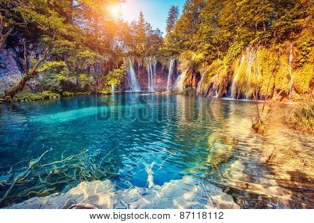 Majestic view on turquoise water and sunny beams in the Plitvice Lakes National Park. Croatia. Europ