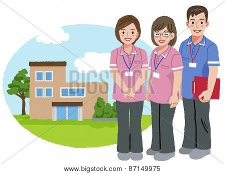 Three caregivers standing with nursing house background. stock photo