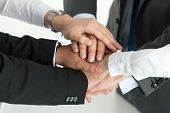 Closeup Of Business Team Showing Unity With Putting Their Hands Together