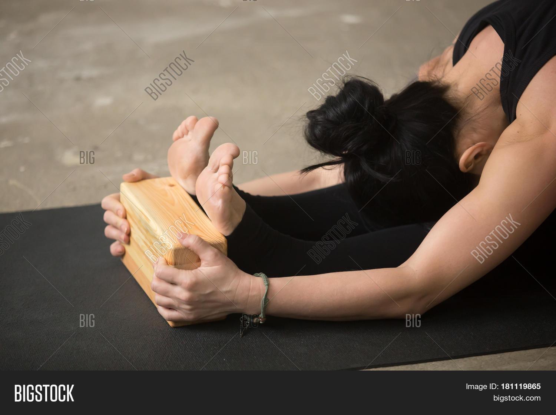Bend,Caterpillar,Intense,activity,advanced,arms,asana,block,brick,class,closeup,doing,dorsal,equipment,exercise,feet,female,fit,fitness,forward,girl,gym,head,health,iyengar,knee,lady,lean,paschimotanasana,paschimottanasana,people,person,pilates,pose,position,posture,practice,prop,seated,sitting,situp,sport,stretch,therapeutic,training,using,woman,workout,yin,yoga