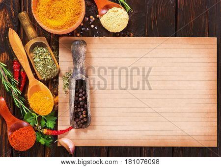 aroma spice in spoons and on a table stock photo