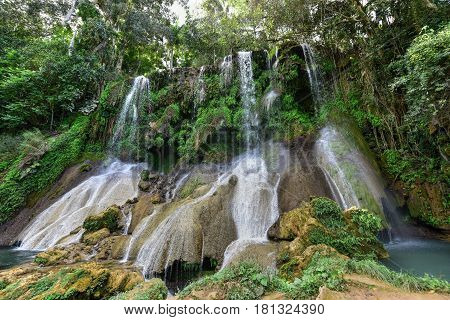 El Nicho Waterfalls in Cuba. El Nicho is located inside the Gran Parque Natural Topes de Collantes a forested park that extends across the Sierra Escambray mountain range in central Cuba. stock photo