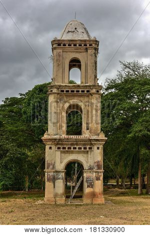 Ruins of the slave tower of the once grand sugar mill Ingenio San Isidro de Los Destiladeros in the Valle de los Ingenios Trinidad Cuba stock photo