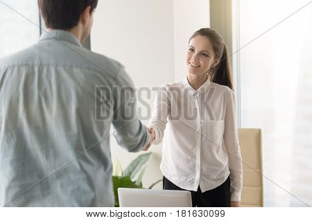 HR manager meeting with job applicant at the office for interview, two smiling business partners making agreement, greeting, handshaking, shaking hands before negotiations. Welcome to our team concept stock photo