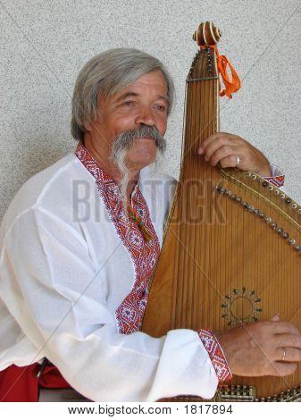 Senior ukrainian folk travelling musician bandurist named Kobzar with instrument bandura stock photo