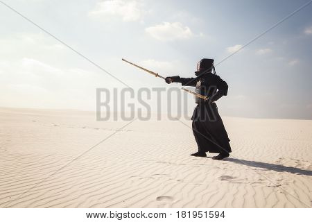 during practice martial art. Tranquility and liberation of the mind in the silence of the desert. stock photo