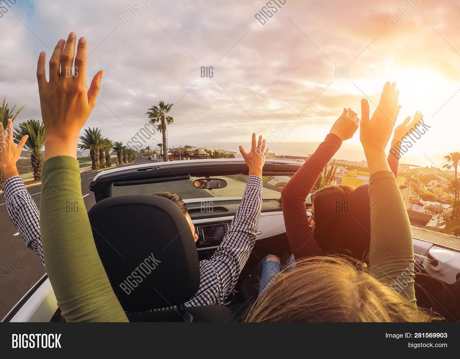 Happy Friends Having Fun In Convertible Car At Sunset In Vacation - Young People Making Party And Da